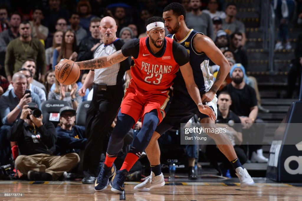 Anthony Davis #23 of the New Orleans Pelicans handles the ball against the Denver Nuggets on December 15, 2017 at the Pepsi Center in Denver, Colorado.