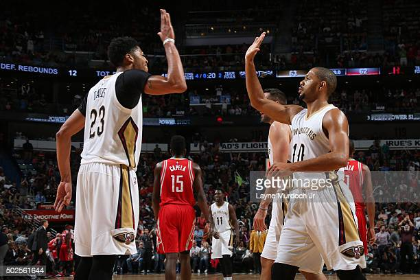 Anthony Davis of the New Orleans Pelicans high fives Eric Gordon of the New Orleans Pelicans' during the game against the Houston Rockets on December...