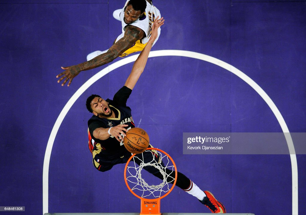 Anthony Davis #23 of the New Orleans Pelicans is fouled by Tarik Black #28 of the Los Angeles Lakers as he goes up for a layup during the second half of the basketball game at Staples Center March 5 2017, in Los Angeles, California.