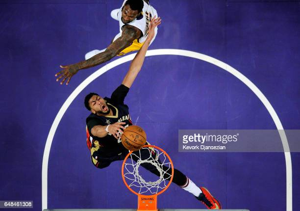 Anthony Davis of the New Orleans Pelicans is fouled by Tarik Black of the Los Angeles Lakers as he goes up for a layup during the second half of the...