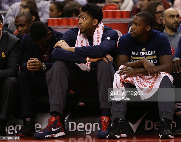 Anthony Davis of the New Orleans Pelicans looks on from the bench during an NBA game against the Toronto Raptors at the Air Canada Centre on November...