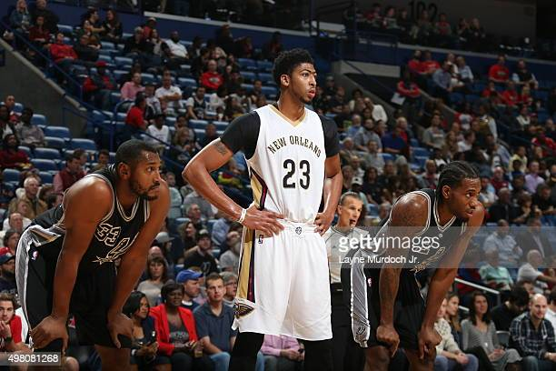 Anthony Davis of the New Orleans Pelicans looks on with Boris Diaw of the San Antonio Spurs and Kawhi Leonard of the San Antonio Spurs on November 20...