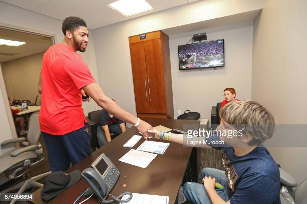 Anthony Davis of the New Orleans Pelicans participates in a game day experience with Ochsner Health System Hero of the Game Allen Dedon before the...