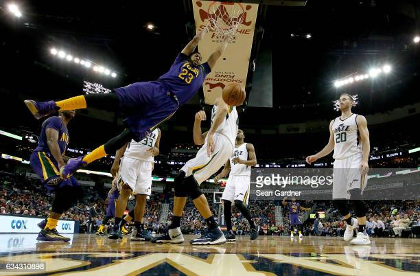 Anthony Davis of the New Orleans Pelicans reacts after dunking the ball against the Utah Jazz during the second half at Smoothie King Center on...