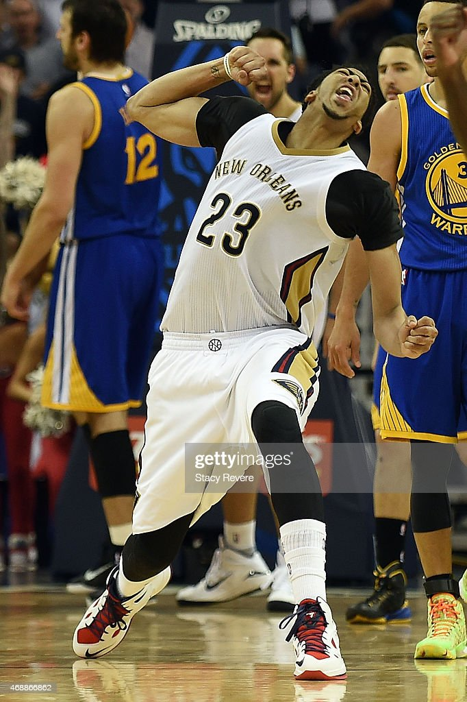 Anthony Davis #23 of the New Orleans Pelicans reacts to a score against the Golden State Warriors late in the second half at the Smoothie King Center on April 7, 2015 in New Orleans, Louisiana.