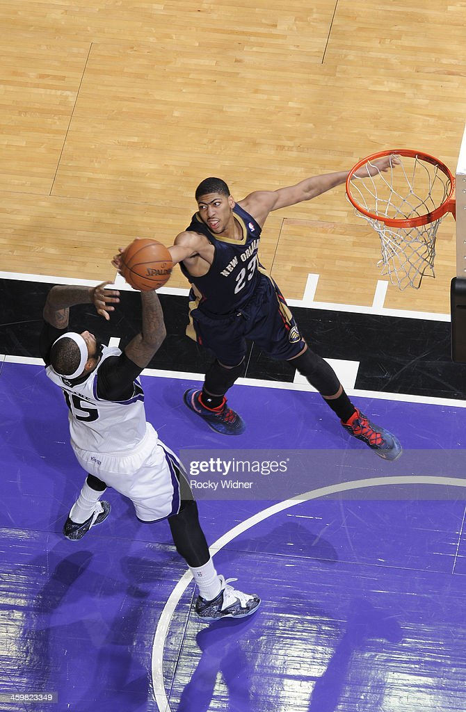Anthony Davis #23 of the New Orleans Pelicans rebounds against <a gi-track='captionPersonalityLinkClicked' href=/galleries/search?phrase=DeMarcus+Cousins&family=editorial&specificpeople=5792008 ng-click='$event.stopPropagation()'>DeMarcus Cousins</a> #15 of the Sacramento Kings on December 23, 2013 at Sleep Train Arena in Sacramento, California.