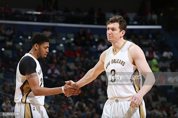 Anthony Davis of the New Orleans Pelicans shakes hands with Omer Asik of the New Orleans Pelicans during the game against the Utah Jazz on March 5...
