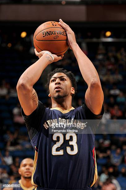 Anthony Davis of the New Orleans Pelicans shoots a free throw against the Orlando Magic during a preseason game on October 21 2015 at Amway Center in...