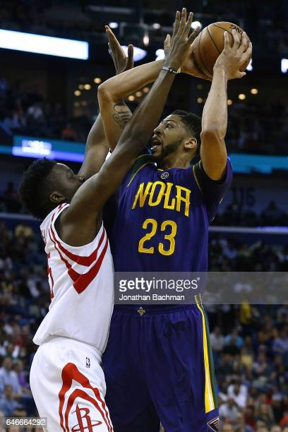 Anthony Davis of the New Orleans Pelicans shoots against Clint Capela of the Houston Rockets during a game at the Smoothie King Center on February 23...