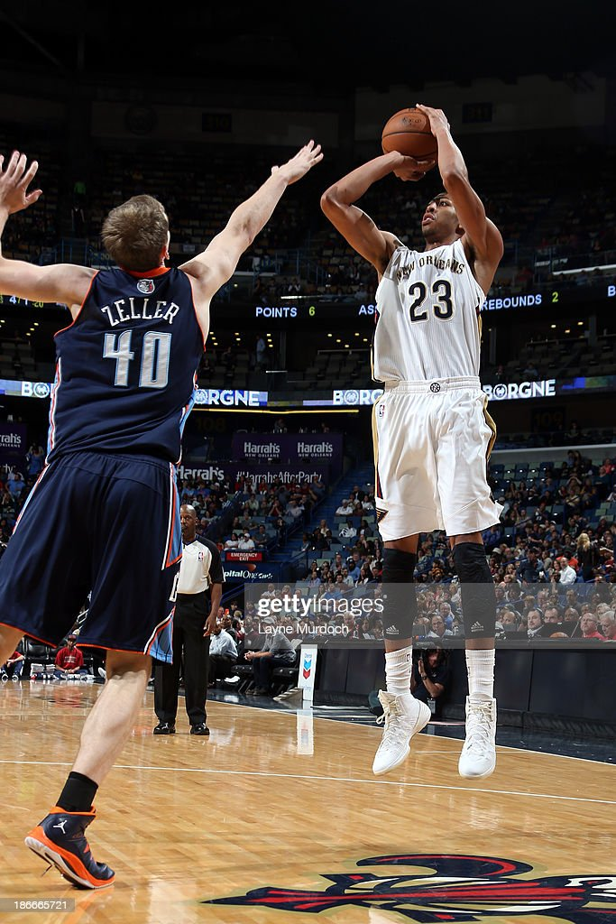 Anthony Davis #23 of the New Orleans Pelicans shoots against <a gi-track='captionPersonalityLinkClicked' href=/galleries/search?phrase=Cody+Zeller&family=editorial&specificpeople=7621233 ng-click='$event.stopPropagation()'>Cody Zeller</a> #40 of the Charlotte Bobcats on November 2, 2013 at the New Orleans Arena in New Orleans, Louisiana.