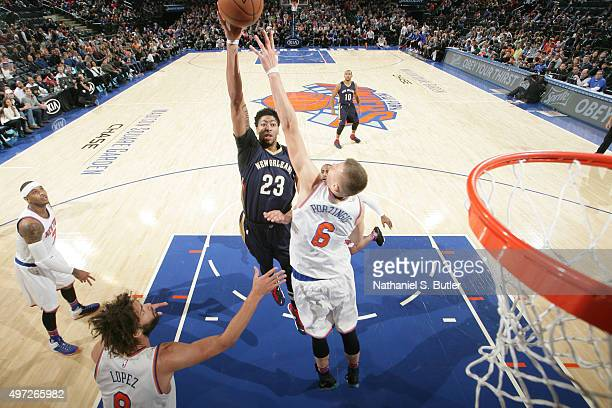 Anthony Davis of the New Orleans Pelicans shoots against Kristaps Porzingis of the New York Knicks during the game on November 15 2015 at Madison...