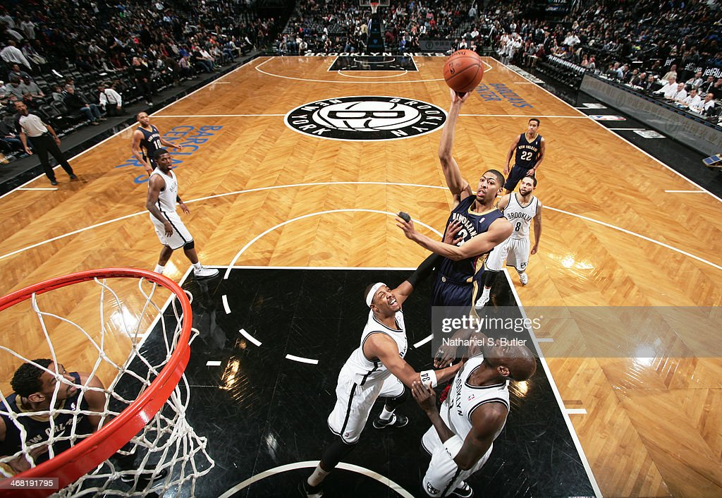 Anthony Davis #23 of the New Orleans Pelicans shoots against <a gi-track='captionPersonalityLinkClicked' href=/galleries/search?phrase=Paul+Pierce&family=editorial&specificpeople=201562 ng-click='$event.stopPropagation()'>Paul Pierce</a> #34 of the Brooklyn Nets during a game at the Barclays Center on February 9, 2014 in the Brooklyn borough of New York City.