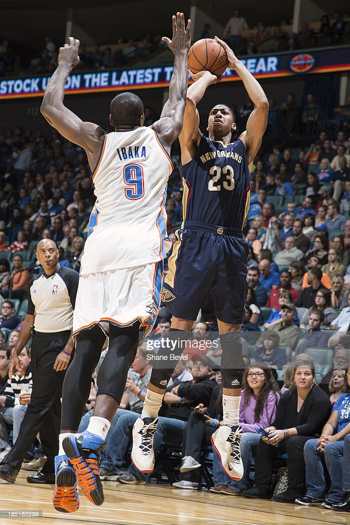 Anthony Davis #23 of the New Orleans Pelicans shoots against <a gi-track='captionPersonalityLinkClicked' href=/galleries/search?phrase=Serge+Ibaka&family=editorial&specificpeople=5133378 ng-click='$event.stopPropagation()'>Serge Ibaka</a> #9 of the Oklahoma City Thunder during the NBA preseason game on October 17, 2013 at the BOK Center in Tulsa, Oklahoma.