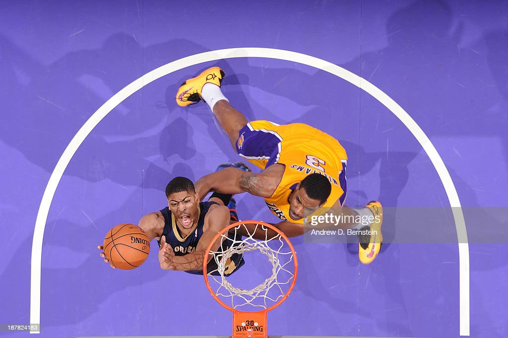 Anthony Davis #23 of the New Orleans Pelicans shoots against Shawne Williams #3 of the Los Angeles Lakers at Staples Center on November 12, 2013 in Los Angeles, California.