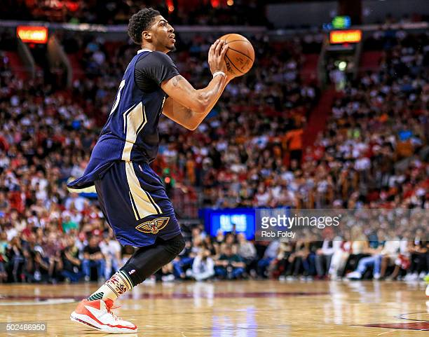 Anthony Davis of the New Orleans Pelicans shoots during the game against the Miami Heat at American Airlines Arena on December 25 2015 in Miami...