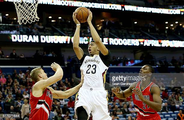 Anthony Davis of the New Orleans Pelicans shoots over Mason Plumlee of the Portland Trail Blazers during the first half at the Smoothie King Center...