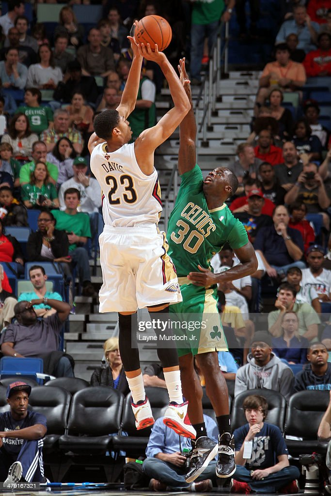 Anthony Davis #23 of the New Orleans Pelicans shoots the ball against the Boston Celtics during an NBA game on March 16, 2014 at the Smoothie King Center in New Orleans, Louisiana.