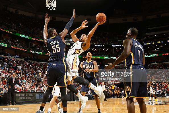 Anthony Davis of the New Orleans Pelicans shoots the ball over Roy Hibbert of the Indiana Pacers at the New Orleans Arena on October 30 2013 in New...