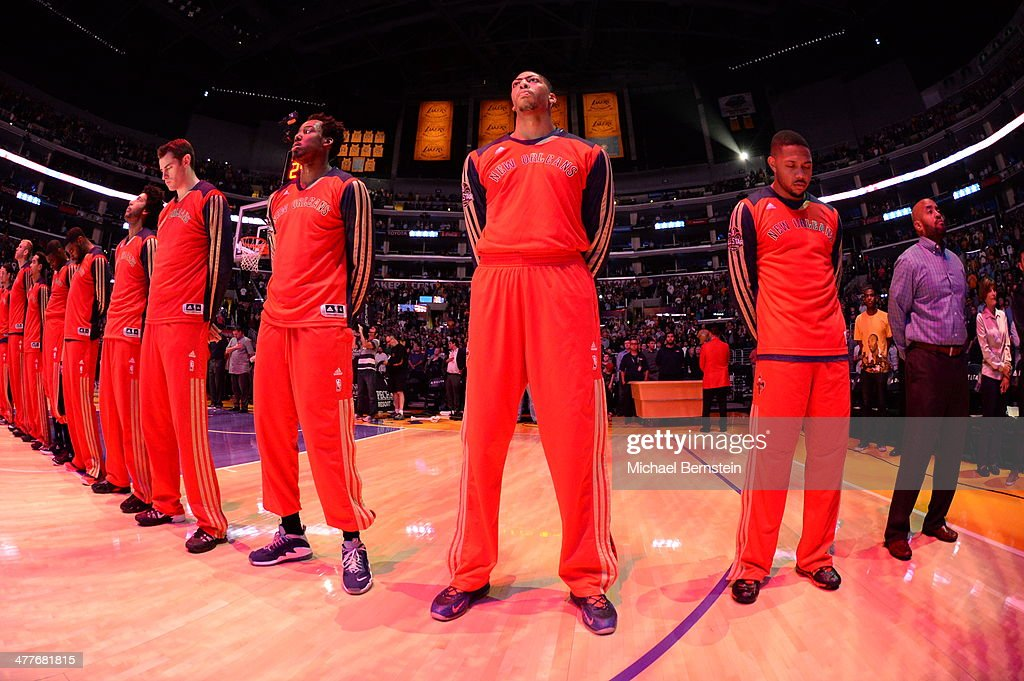 Anthony Davis #23 of the New Orleans Pelicans stands in observance of the national anthem before a game against the Los Angeles Lakers at Staples Center on November 12, 2013 in Los Angeles, California.