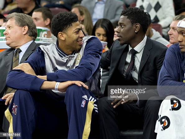 Anthony Davis of the New Orleans Pelicans talks to Jrue Holiday on the bench during the game against the Philadelphia 76ers on January 16 2015 at the...