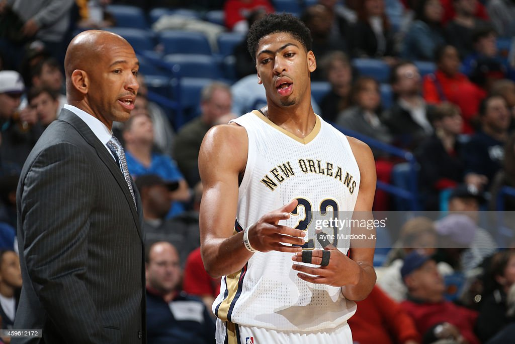 Anthony Davis of the New Orleans Pelicans talks with Monty Williams during the game against the Sacramento Kings on November 25 2014 at the Smoothie...