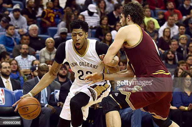 Anthony Davis of the New Orleans Pelicans works against Kevin Love of the Cleveland Cavaliers during the first half of a game at the Smoothie King...