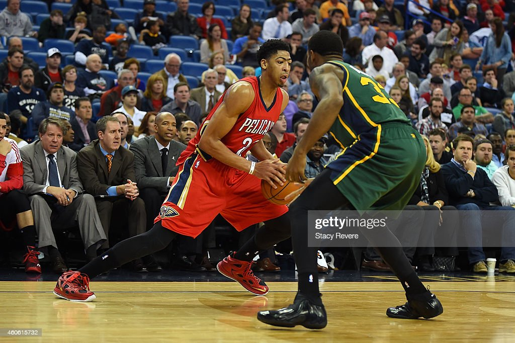Anthony Davis of the New Orleans Pelicans works against Trevor Booker of the Utah Jazz during the second half of a game at the Smoothie King Center...