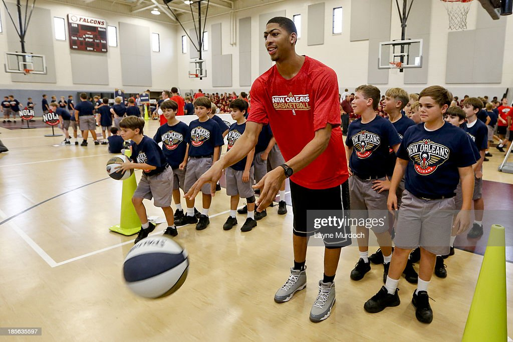 Anthony Davis of the New Orleans Pelicans works with students as the team partnered with Ochsner Health System, Blue Cross Blue Shield of Louisiana and the Louisiana Campaign for Tobacco-Free Living (TFL) celebrate the launch of the Pelicans Junior Training Camp program on October 21, 2013 at Christian Brothers School in New Orleans, Louisiana.
