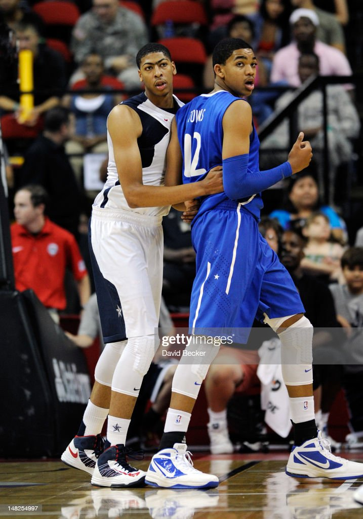 Anthony Davis of the US Men's Senior National Team and Karl Towns of the Dominican Republic guard each other during a preOlympic exhibition game at...