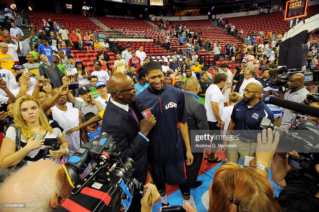 Anthony Davis #42 of the USA Blue Team speaks to legend Clyde Drexler the media after the 2013 USA Basketball Showcase at the Thomas and Mack Center on July 25, 2013 in Las Vegas, Nevada.
