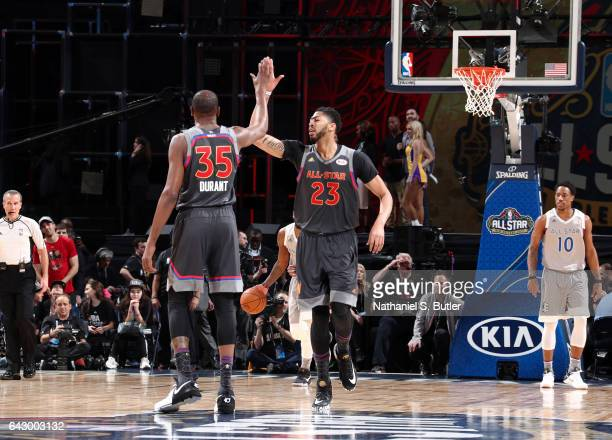 Anthony Davis of the Western Conference AllStars and Kevin Durant of the Western Conference AllStars react during the NBA AllStar Game as part of the...