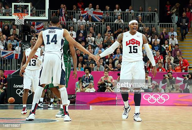 Anthony Davis of United States and teammate Carmelo Anthony celebrate during the second half against Nigeria in the Men's Basketball Preliminary...