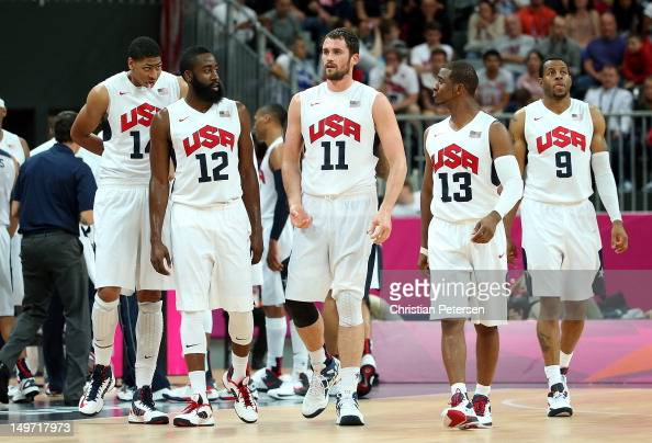 Anthony Davis of United States and teammates James Harden Kevin Love Chris Paul and Andre Iguodala walk onto the court during the second half against...