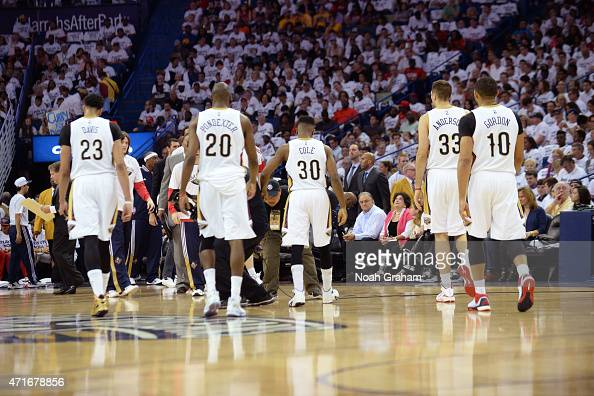 Anthony Davis Quincy Pondexter Norris Cole Ryan Anderson and Eric Gordon of the New Orleans Pelicans walk off the court against the Golden State...