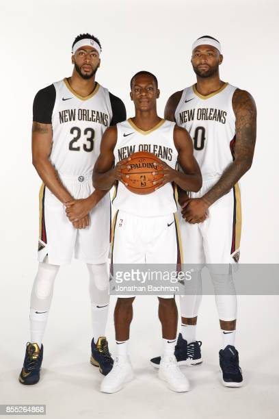 Anthony Davis Rajon Rondo and DeMarcus Cousins of the New Orleans Pelicans pose for a portrait during media day on September 25 2017 at Smoothie King...