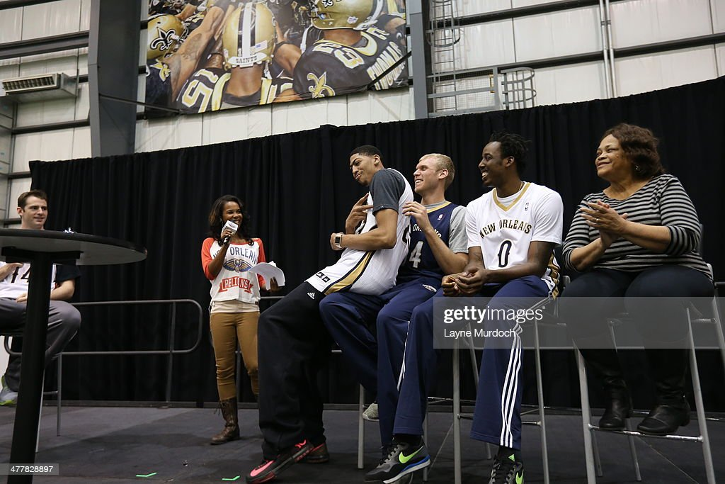 Anthony Davis sits on the lap of Greg Stiemsma of the New Orleans Pelicans at the team hosts a season ticket holders event on March 8 2014 at the New...