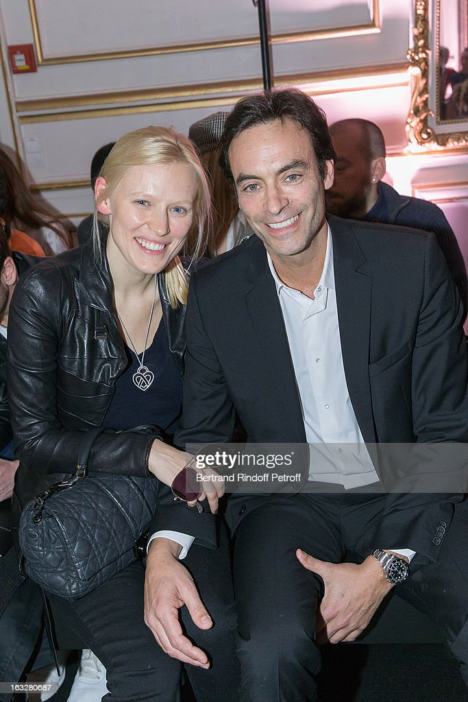 Anthony Delon (R) and Anna Sherbinina attend the Jitrois Fall/Winter 2013 Ready-to-Wear show as part of Paris Fashion Week on March 6, 2013 in Paris, France.