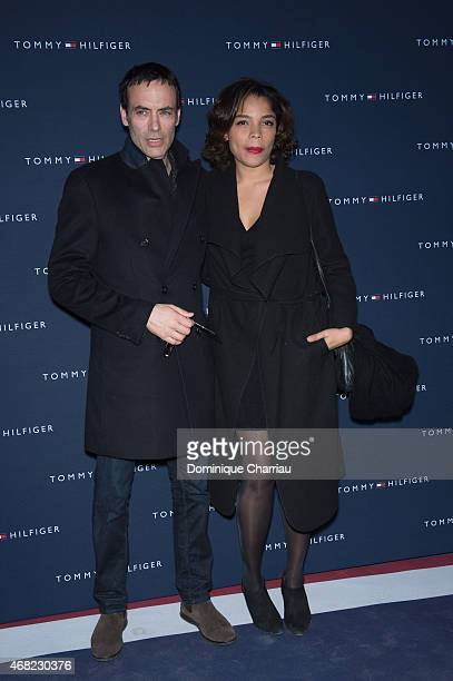 Anthony Delon and Jina Djemba attend theTommy Hilfiger Boutique Opening At Boulevard Capucines In Paris on March 31 2015 in Paris France