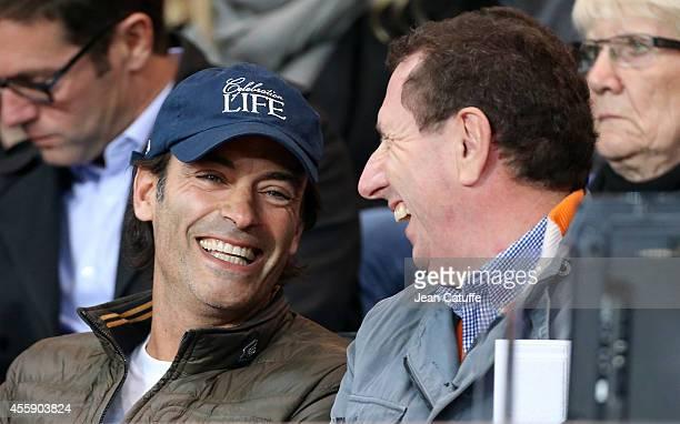Anthony Delon and Pierre Botton attend the French Ligue 1 match between Paris SaintGermain FC and Olympique Lyonnais OL at Parc des Princes stadium...