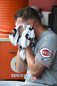 Anthony DeSclafani of the Cincinnati Reds wipes down in the dug out during a baseball game against the Washington Nationals at Nationals Park on July...