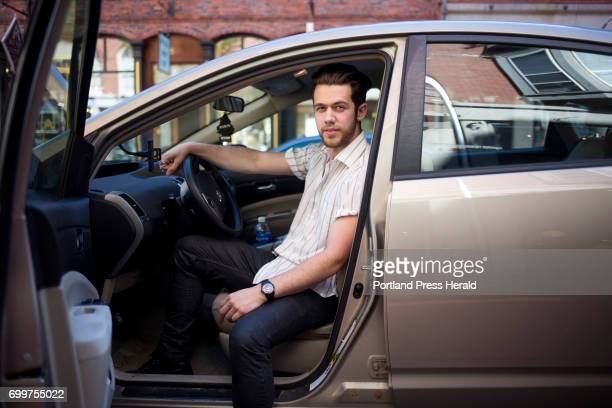 Anthony DiBiase poses for a photo in his car on Exchange street DiBiase is an Uber driver and said the proposed law that would make it illegal to use...