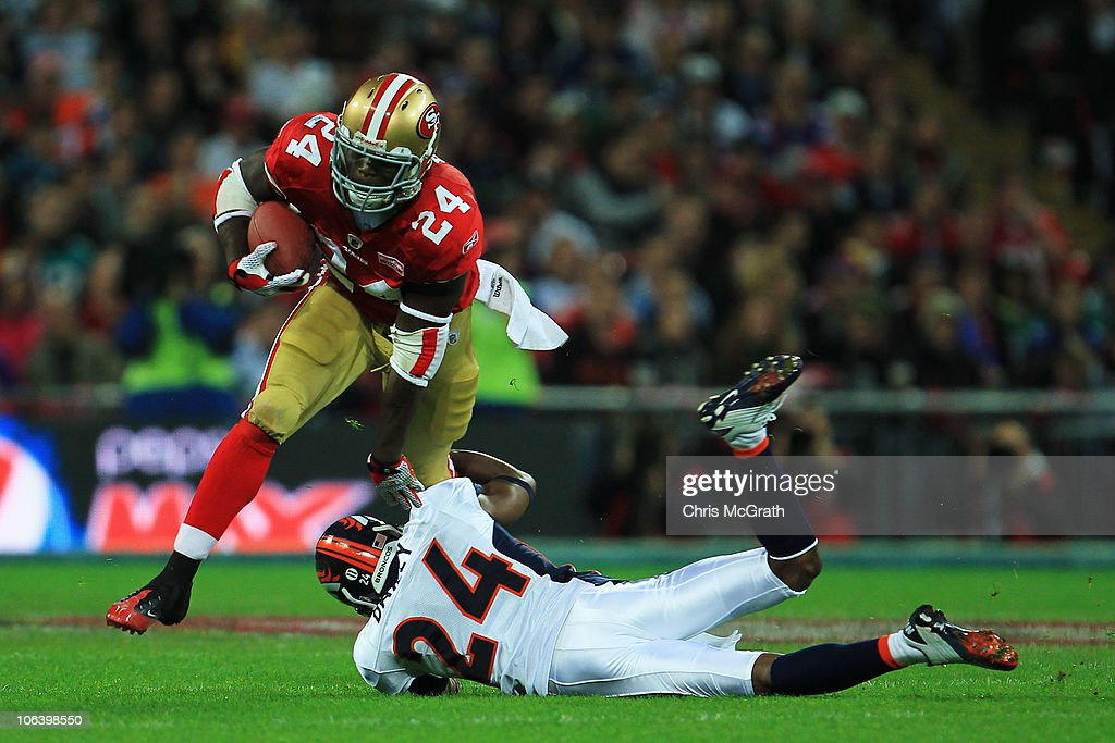 Anthony Dixon #24 of San Francisco 49ers is tackled by Champ Bailey #24 of Denver Broncos during the NFL International Series match between Denver Broncos and San Francisco 49ers at Wembley Stadium on October 31, 2010 in London, England. This is the fourth occasion where a regular season NFL match has been played in London.