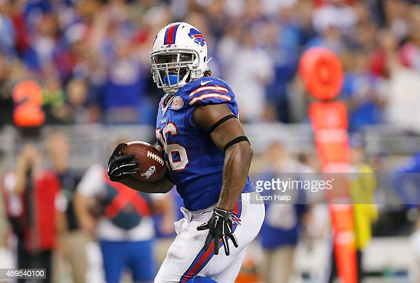 Anthony Dixon of the Buffalo Bills scores a 30 yard touchdown in the fourth quarter while playing the New York Jets at Ford Field on November 24 2014...