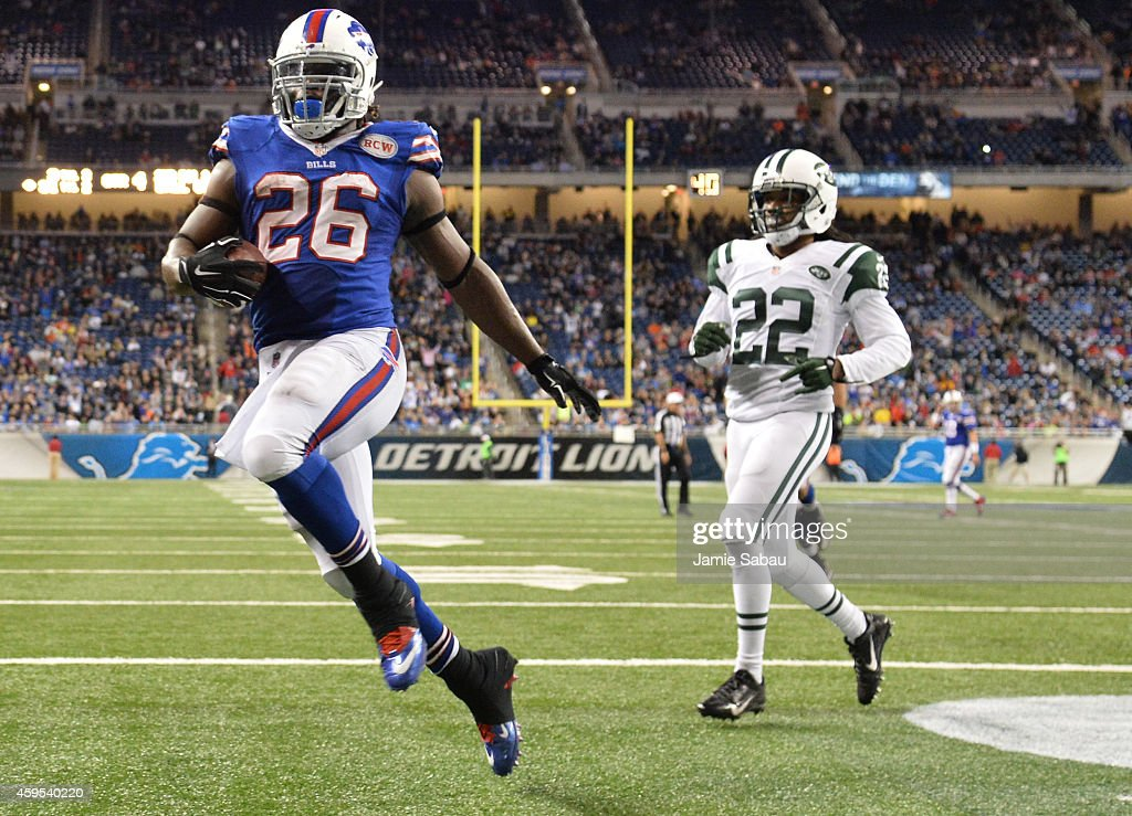 Anthony Dixon #26 of the Buffalo Bills scores a fourth quarter touch down against the New York Jets at Ford Field on November 24, 2014 in Detroit, Michigan.