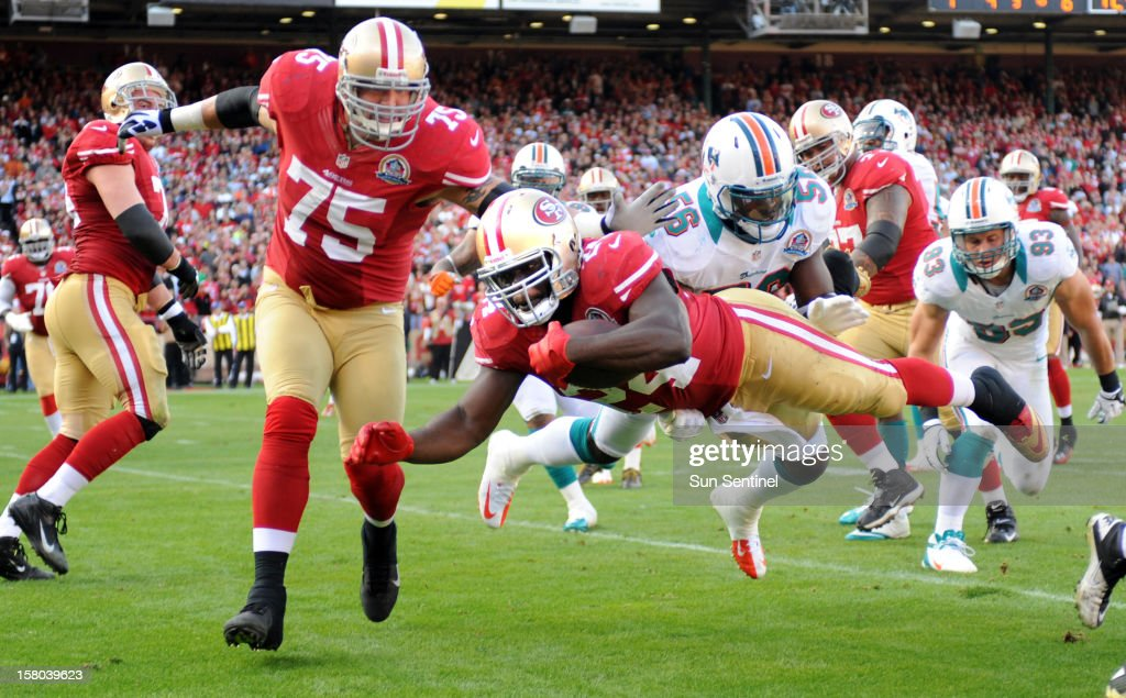 Anthony Dixon of the San Francisco 49ers dives down to the 1-yard line to set up a touchdown against the Miami Dolphins at Candlestick Park in San Francisco, California, on Sunday, December 9, 2012. The San Francisco 49ers defeated the Miami Dolphins, 27-13.