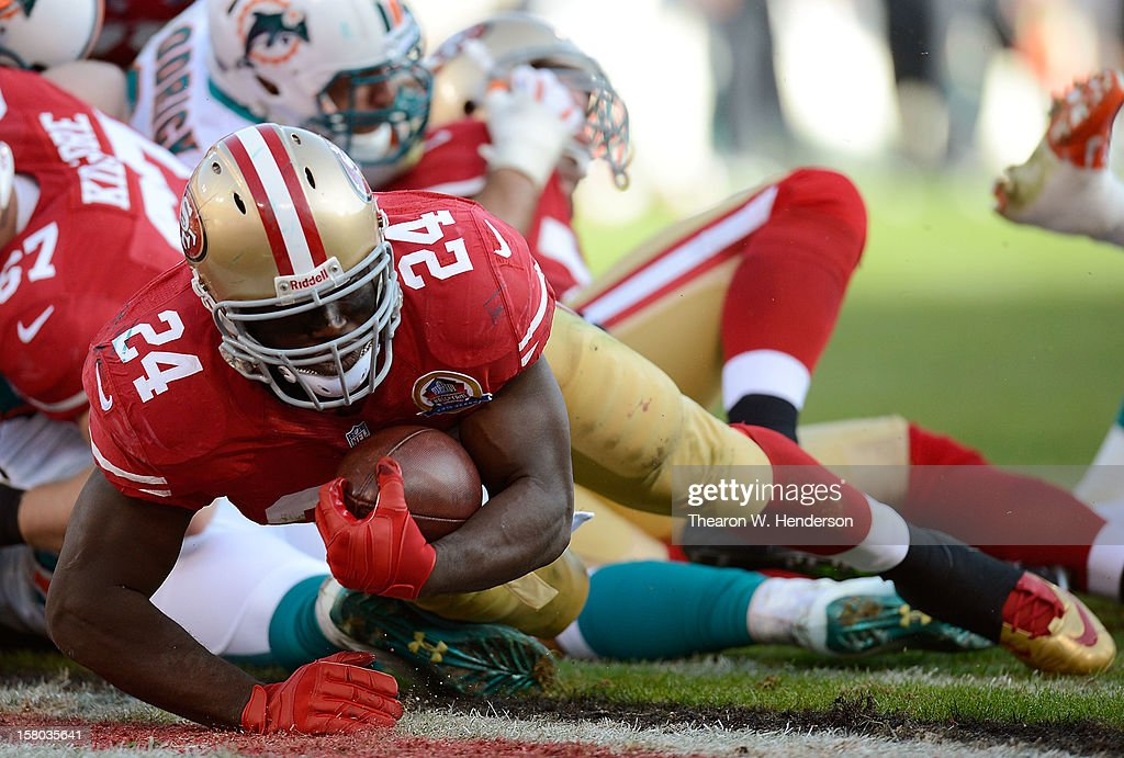 Anthony Dixon #24 of the San Francisco 49ers scores a touchdown on a one-yard run in the fourth quarter against the Miami Dolphins at Candlestick Park on December 9, 2012 in San Francisco, California. The 49ers won the game 27-13.