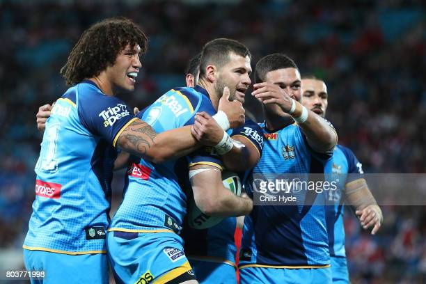 Anthony Don of the Titans celebrates after scoring a try with team mates during the round 17 NRL match between the Gold Coast Titans and the St...