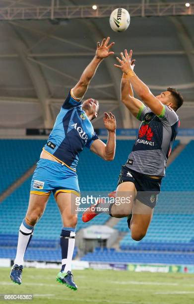Anthony Don of the Titans contests a high ball with Nick Cotric of the Raiders during the round six NRL match between the Gold Coast Titans and the...