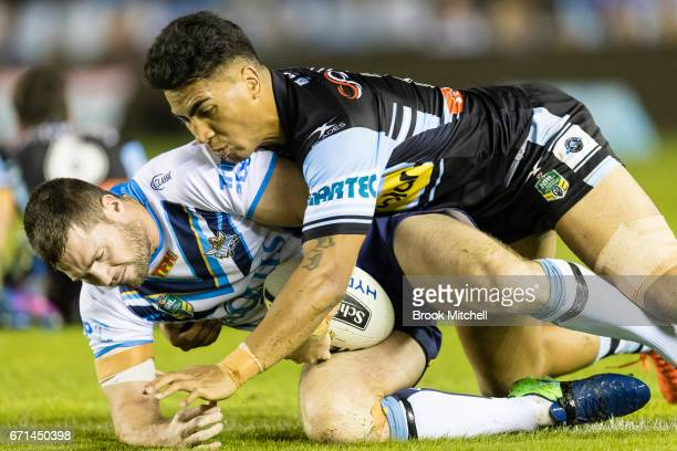 Anthony Don of the Titans is tackled during the round eight NRL match between the Cronulla Sharks and the Gold Coast Titans at Southern Cross Group...