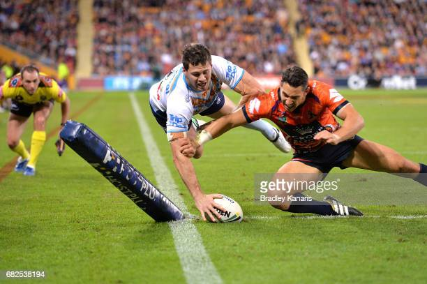 Anthony Don of the Titans scores a try during the round 10 NRL match between the Melbourne Storm and the Gold Coast Titans at Suncorp Stadium on May...